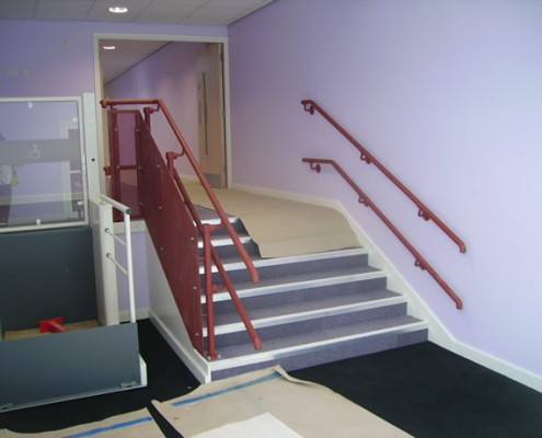 Bespoke tubular handrail with mesh infill to staircase