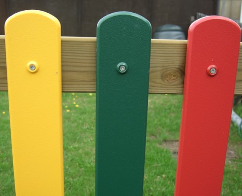 Coloured plastic palisade children's fencing close up