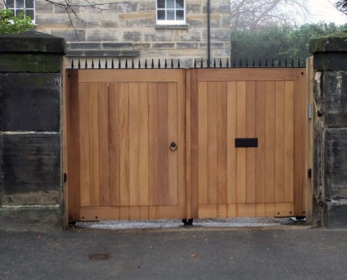 Bespoke hardwood entrance gates with letter box and metal details