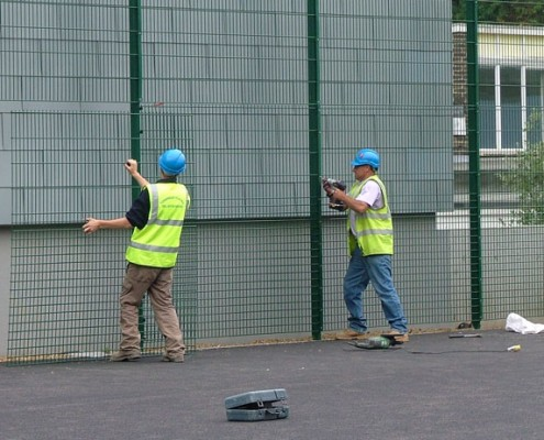 Security mesh fencing being installed
