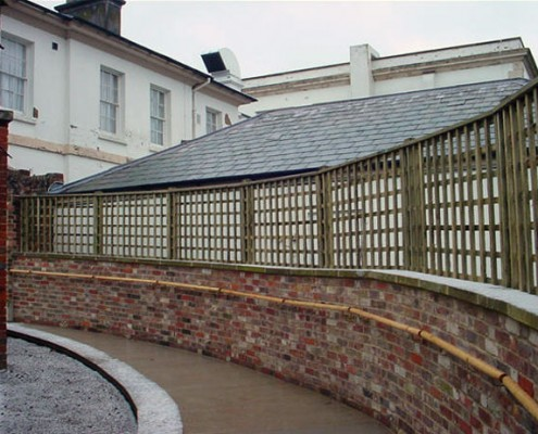 Trellis panels on top of a wall