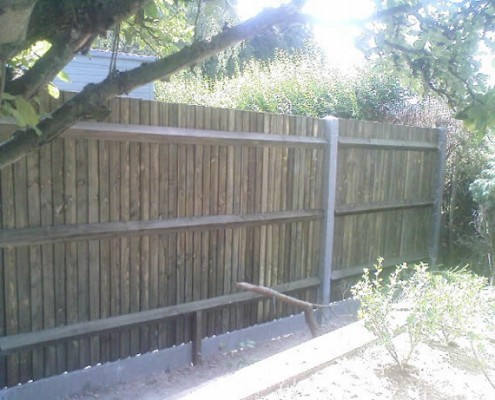 Closeboard fencing on concrete posts with concrete gravel boards