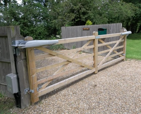 Wooden field gate in softwood at end of drive automated with voice entry system to house