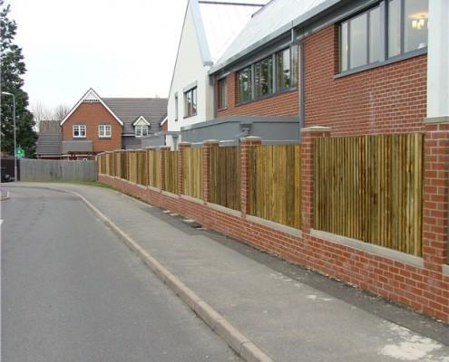 closeboard fencing between brick piers