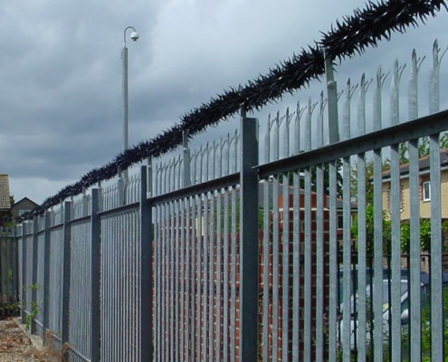 anti vandal scaling barrier above a steel palisade fence