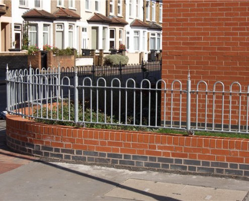 Steel railings installed on top of a wall