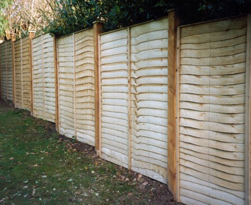 waney edge fence panel installed